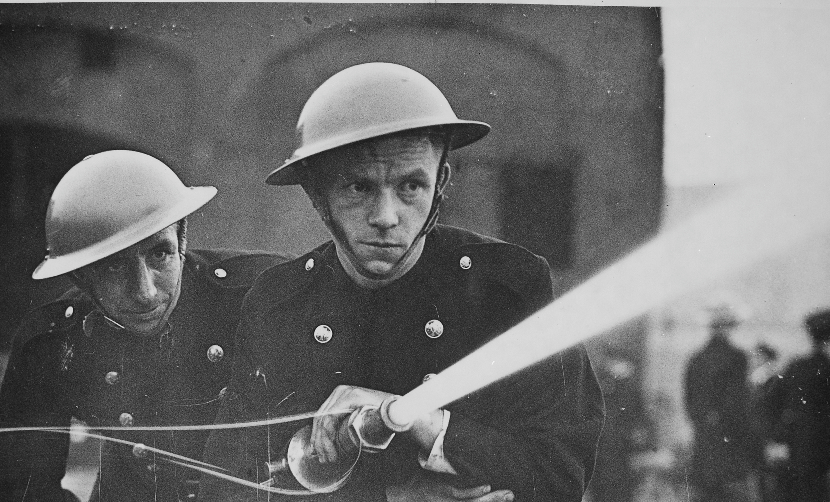 A black and white photograph of historical firefighters