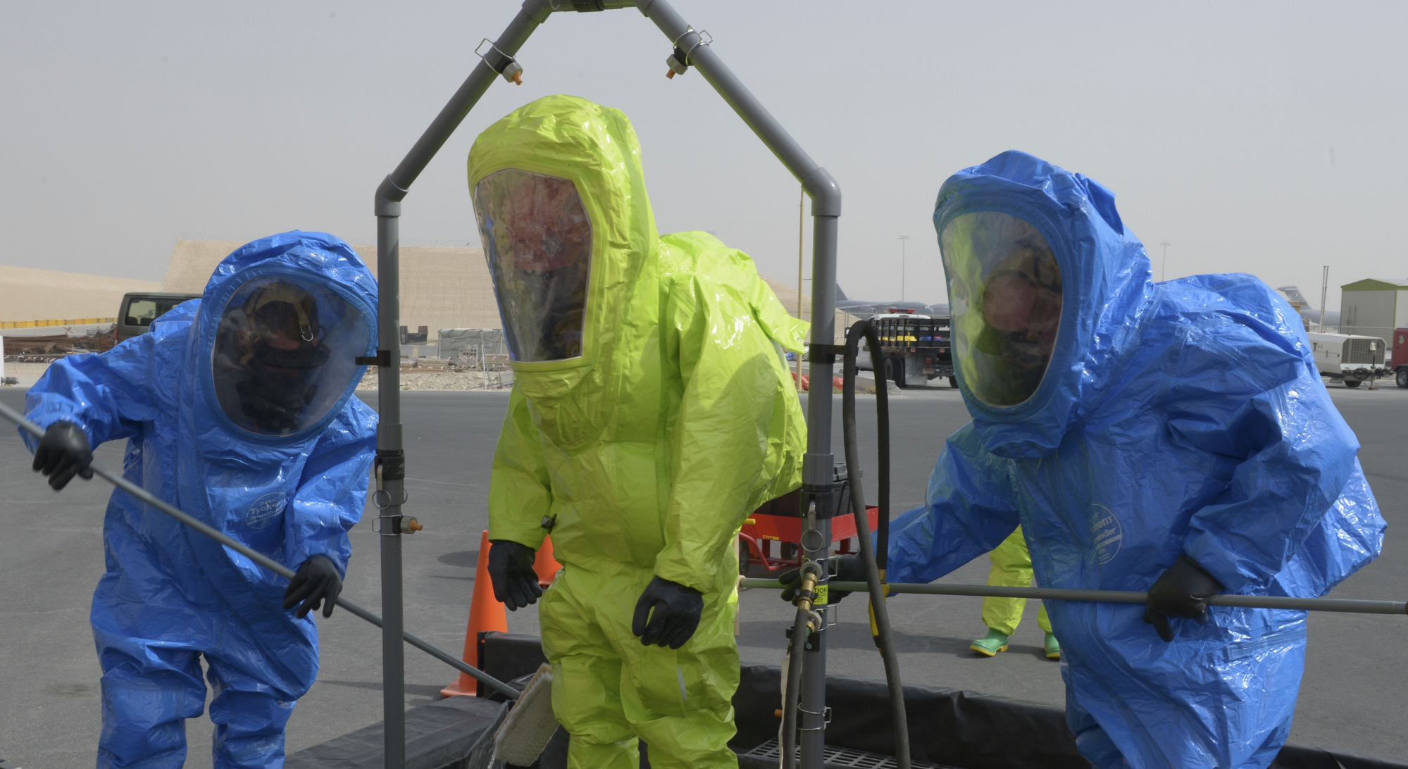 Three first responders in hazmat suits