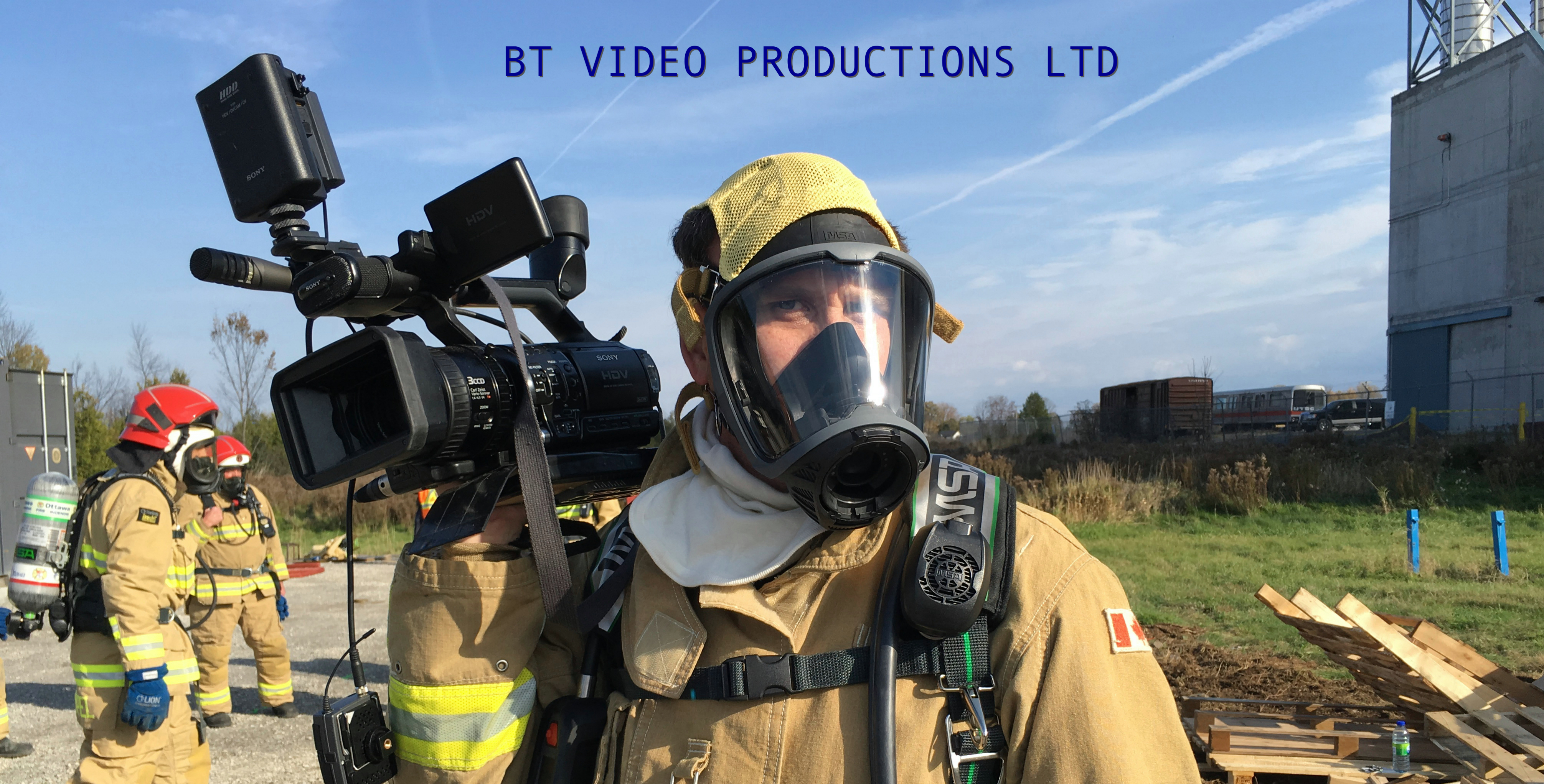 A firefighter in full gear with a video camera