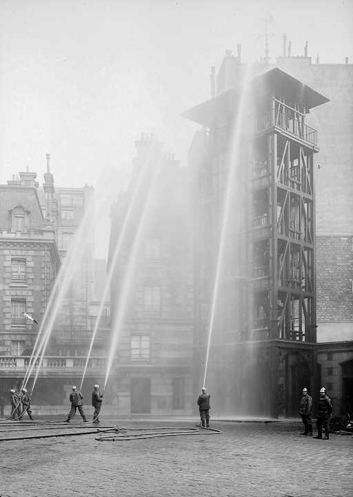 Paris firefighters during an exercise around the year 1900 when CTIF International Association of Fire Services was founded. Photo by Wikipedia