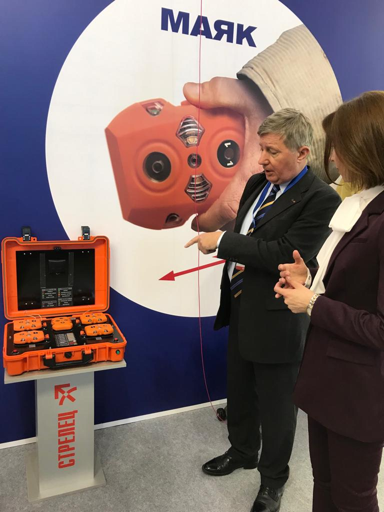CTIF vice president Milan Dubravac studies a fire fighting robot at the ISSE exhibition.