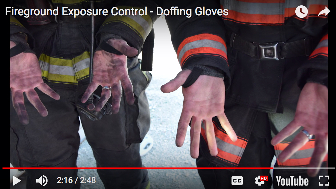 Screenshot from the video showing how contamination on your hands can be avoided by using latex gloves when handling your fire gear.