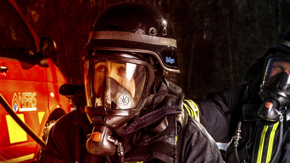 A female firefighter fighting a fire