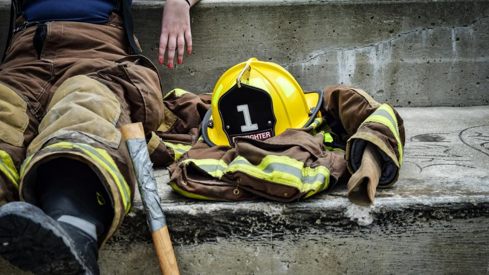 Firefighter with dirty gear and helmet