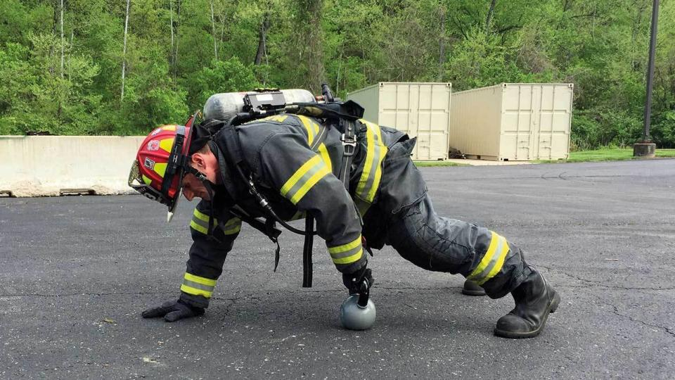 Firefighter exercising doing pushups. Photo: Wikipedia Commons License.