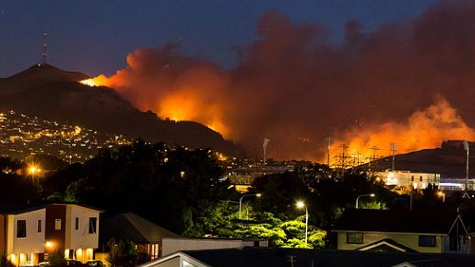 Photo: (Above) The 2017 Port Hills fires were wildfires in the Port Hills of Christchurch, New Zealand. Two separate fires, several kilometres apart, started on Monday afternoon on 13 February 2017. By Wednesday night, the fires had combined to one large area. A helicopter crashed helping to fight the fires, causing the death of the pilot. Nine houses were destroyed and a further two were significantly damaged by the fires, and hundreds of residents were evacuated.