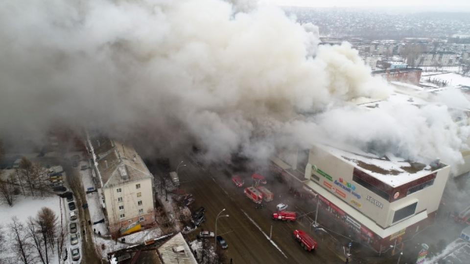 In this Russian Emergency Situations Ministry photo, on Sunday, March 25, 2018, smoke rises above a multi-story shopping center in the Siberian city of Kemerovo, about 3,000 kilometers east of Moscow, Russia.