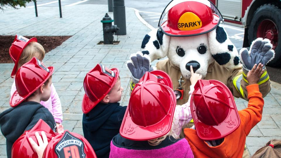 Sparky the Dog and kids in fire helmets