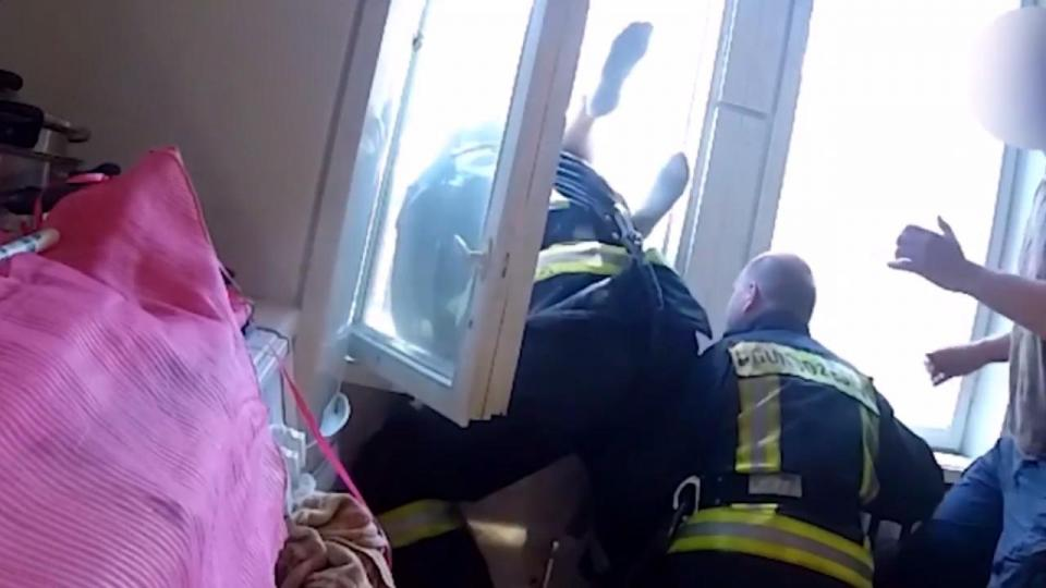 Latvian firefighters catch a suicidal jumper in a fall from the fourth floor. Screen dump from the fire service´video.