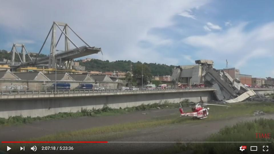 A view of the collapsed bridge in Genua with a rescue helicopter and fire trucks. Screen dump from Time´s yourtube channel.