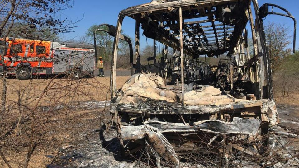 The burned out frame of the bus after the explosion and fire