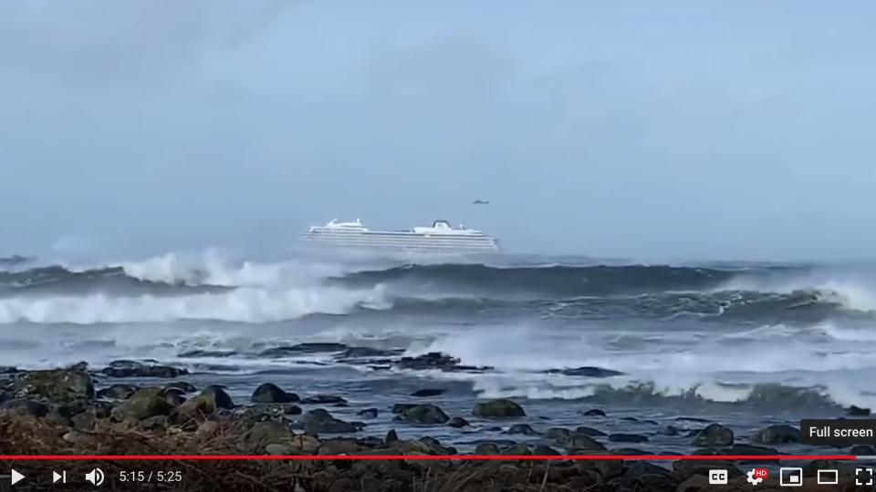 Viking Sky seen battling the waves just a short distance off the coast of Norway. Screen dump from a video by The Score YouTube station.
