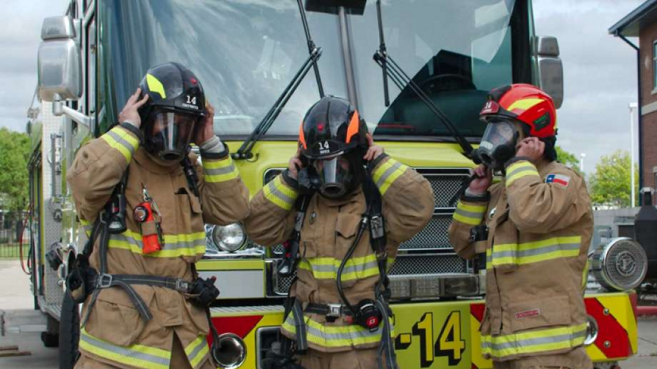 Webster firefighters Jason Crockom, Jeremy Falcone and Shane Martin strap on their new helmets. (Kirk Sides / Staff Photographer)