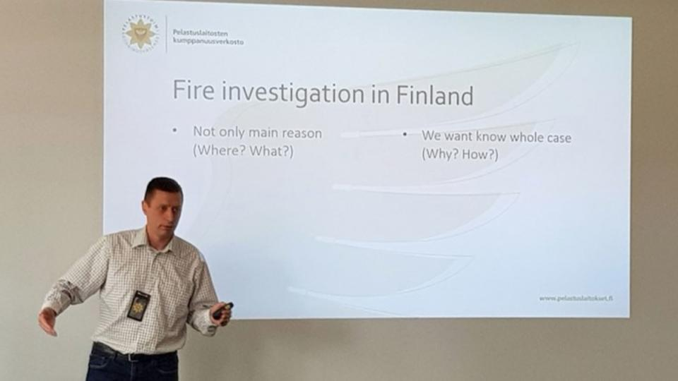 A speaker from the Finnish Fire Investigation Delegation at the CTIF meeting.