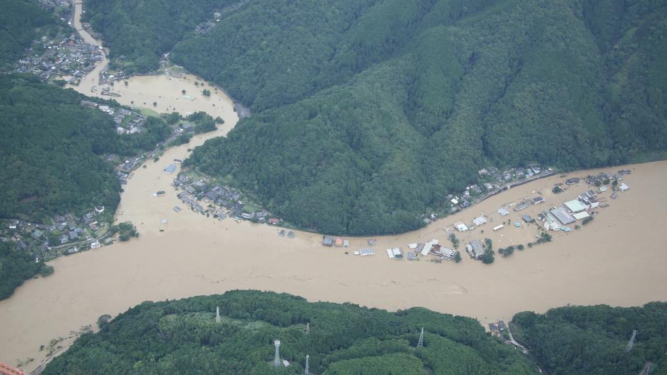 A flooded river destroying a community during the 2020 torrential rain storm in Japan. (Geospatial Information Authority of Japan) Photo courtesy of Wikipedia.