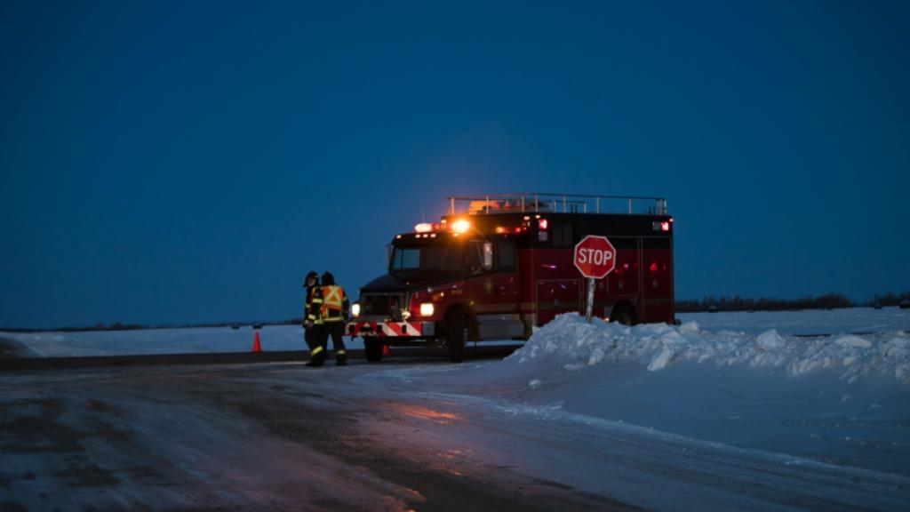 Emergency workers were on scene late into the evening on Friday, after a team bus collided with a semi-trailer south of Nipawin, Sask. (Submitted by Kymber Rae Photography )