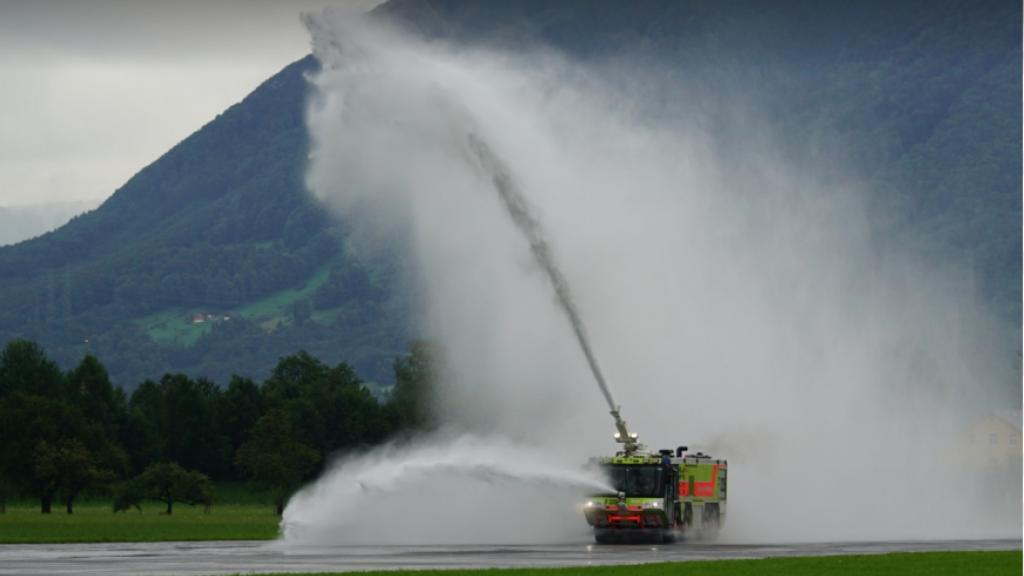 A firefighting truck practicing with foam at an airport. Photo by Ph Sphere